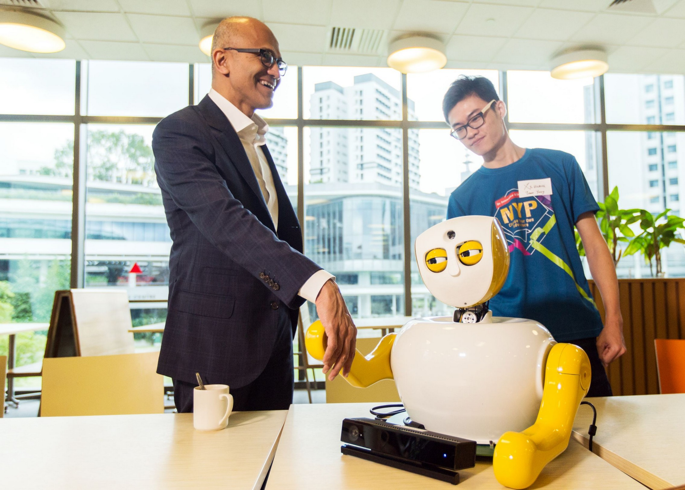 Microsoft CEO Satya Nadella meeting Ruth, an innovative social robot designed by student developers from Nanyang Polytechnic to assist the elderly as a personal assistant.